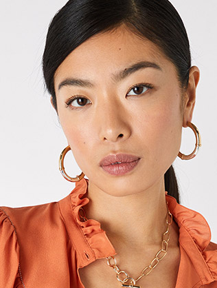 Two tone hoop earring with recycled metal